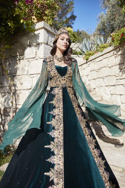 Velvet evening dress in green color
